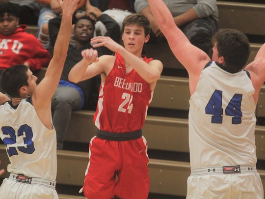 Beechwood guard Scotty Draud is double-teamed by CovCath seniors Casey Nowak, 23, and Jake Walter, 44, during the 35th District boys basketball semifinals between Covington Catholic and Beechwood Feb. 21, 2018 at Holmes HS, Covington KY. CovCath led 39-23 at the half.