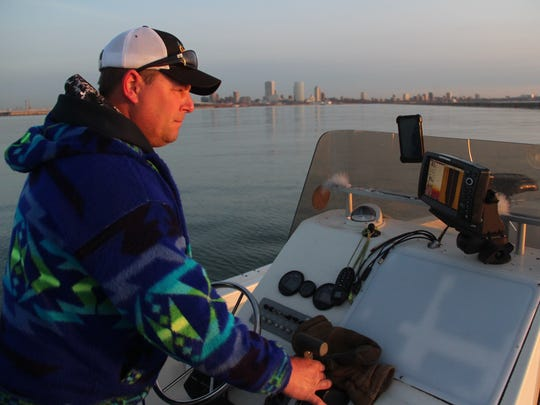 Brian Settele of Menomonee Falls monitors his sonar