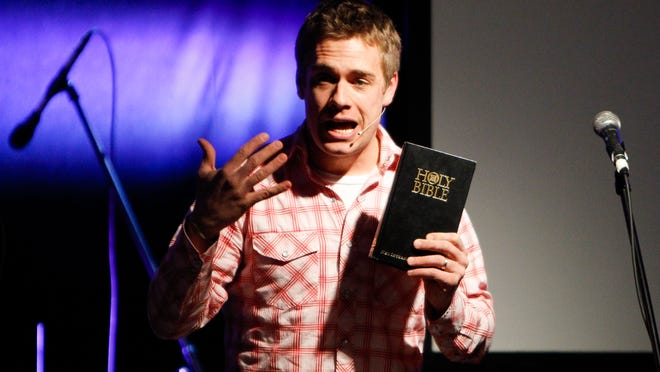 """Crossroads Church Pastor Noah Filipiak delivers a sermon on Genesis Tuesday at The Loft in downtown Lansing, where a congregation of over 60 people gathered   for the premiere of the church's weekly gathering of """"The Upper Room"""" or """"Church at the Loft."""""""