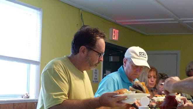Members enjoyed traditional barbecue fare, catered by Two Guys catering, during ENMA's annual barbecue social. The event is one of the many events ENMA hosts annually to bring East Naples business owners together.