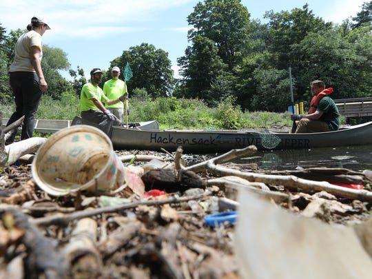 Volunteers gather at the edge of the Woodcliff Lake