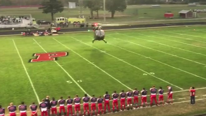 The Michigan National Guard is investigating whether state Rep. Tom Barrett broke the rules when he landed a helicopter on a high school football field to deliver the ball in early October.