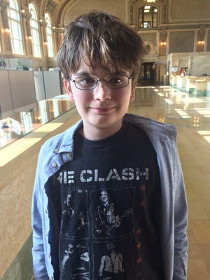 Finn Andersen, 13, showed up at Des Moines City Council Monday to request a change in a local ordinance that bans youth from music venues after 9 p.m. He unbuttoned his nice collared shirt after leaving the council chambers to show a band T-shirt for The Clash underneath.