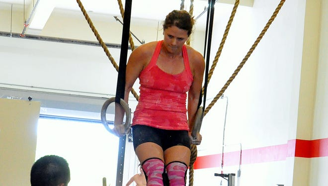 Irene Henderson gets the thumbs up for a successful muscle up during day two of competition at the Inaugural 2016 Latte Games held from Jan. 16-17 at the CrossFit Latte Stone Gym in Harmon.