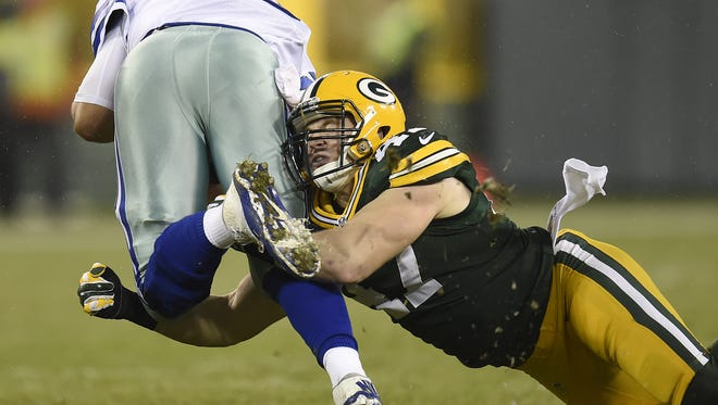 Green Bay Packers linebacker Jake Ryan (47) tackles Dallas Cowboys quarterback Matt Cassel in a game at Lambeau Field.