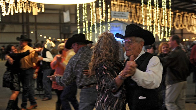 Times Record News File PhotoCouples dance around the floor at the 2014 Cattle Baron's Ball at the J.S. Bridwell Agricultral Center.