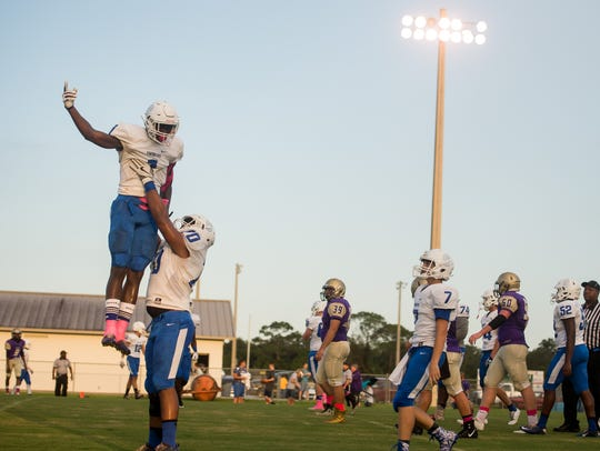 Sebastian River's Corbin Gibson is hoisted into the