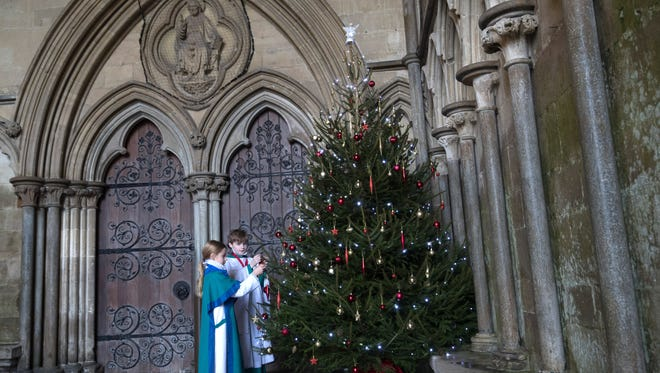 Choristers from the Salisbury Cathedral Choir decorate a Christmas tree ahead of their final practice before services that will be held in the cathedral marking Christmas on Dec. 22, 2017 in Salisbury, England.