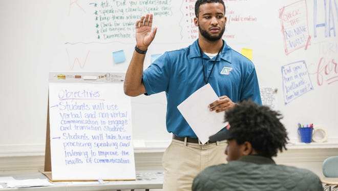 Teacher  Nathan McCalla instructs students during the Intro To Elevate class at Arsenal Technical High School on Friday, Sept. 9, 2016. The mentoring course includes learning character qualities and life skills to end generational poverty.