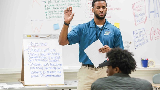 Teacher, Mr. Nathan McCalla instructs students during the Intro To Elevate class at Arsenal Technical High School, Friday September 9th, 2016. The mentoring course includes learning character qualities and life skills to end generational poverty.