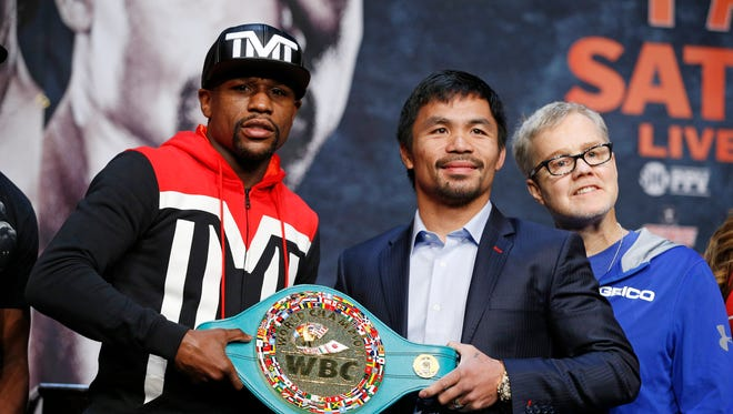 Floyd Mayweather Jr., left, and Manny Pacquiao pose with a WBC belt during a press conference Wednesday, April 29, 2015, in Las Vegas.