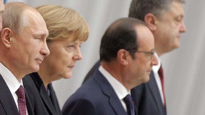 From left, Russian President Vladimir Putin, German Chancellor Angela Merkel, French President Francois Hollande and Ukrainian President Petro Poroshenko met for cease-fire talks in Minsk, Belarus, Feb. 11.