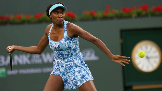 Venus Williams hits during her match against Kurumi Nara at the Indian Wells Tennis Garden during the BNP Paribas Open, March 11, 2016.