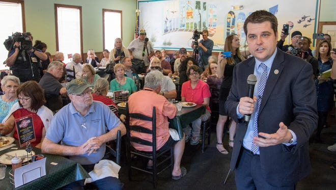 """U.S. Rep. Matt Gaetz answers questions during an """"Open Gaetz Day"""" event at Grover T's BBQ in Milton, Florida on Thursday, February 23, 2017. Gaetz intends to push for cost transparency in Republicans' Obamacare repeal."""