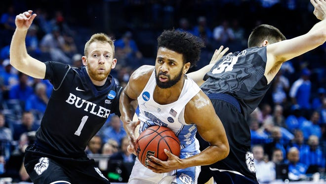 University of North Carolina guard Joel Barry II (middle) drives the lane against the Butler University defense during first half action of their NCAA tournament Sweet Sixteen matchup at the FedExForum.