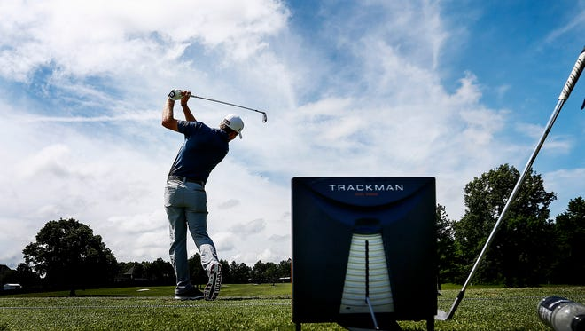 PGA tour golfer John Peterson uses the TrackMan device to works on his swing during professional practice rounds at the FedEx St. Jude Classic at TPC Southwind, Tuesday morning. The TrackMan assists golfer looking to improve their swing using precise data analysis.