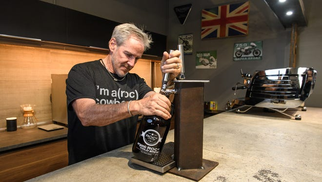Dave Anderson celebrates the 20th anniversary of The Roastery of Cave Creek on Wednesday, Nov. 15, 2017, in Cave Creek, Ariz.