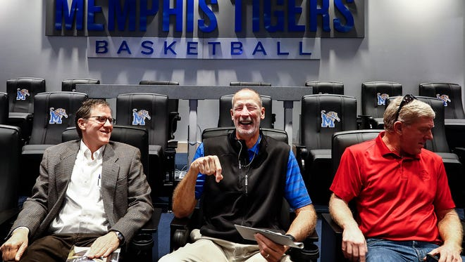 Former Tiger basketball player Hank McDowell (middle) enjoys the digs in the video room at the University of Memphis' new state of the art Laurie-Walton Family Basketball Center during a ribbon-cutting ceremony on Park Avenue Campus. The practice facility becomes the home of the Tiger's men's basketball program.