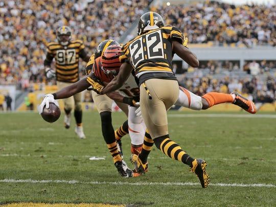 Cincinnati Bengals wide receiver A.J. Green dives across