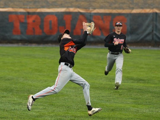 Palmyra second baseman Chris Good snares a pop-up during the Cougars' 3-0 win at Hershey on Wednesday.