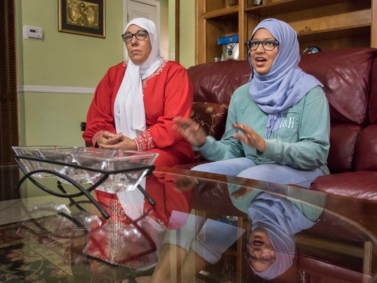 Rachida Jacobs, left, listens as her daughter Seham, 14, talks about her experience being one of the few Muslims in her school.