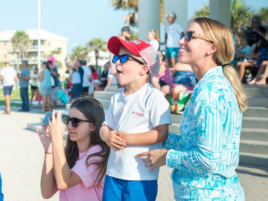 Tara Harmon, left to right, Kyler Bernard, 4, and mom Ashley Bernard watch the Blue Angels fly during Breakfast with the Blues over Pensacola Beach on Wednesday, July 11, 2018.