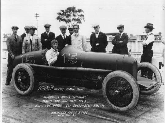 - JOE BOYER, shown seated in #15, drove the final 89 laps of the Duesenberg to win the 1924 Indianpolis 500 Mile Race. Boyer started the race in #9, another Duesenberg that crashed on lap 176. L. L. (Slim) Corum  started in #15 and was relieved by Boyer after driving 111 laps. A new average race speed of 98.234 m.p.h was set by both drivers.  Others shown around winning car include crew members but there is no other identification. (NOTE: This is believed to be the first IMS photo of the 1924 winner.  The second showis Corum and Fred Duesenberg insert.)