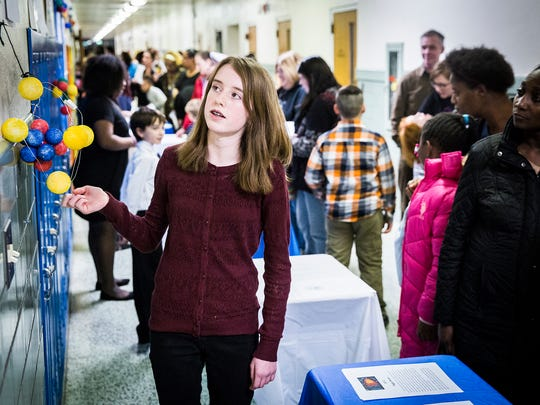 Madeline Fisher gives a presentation during Inspire Academy's exhibition night Wednesday evening.