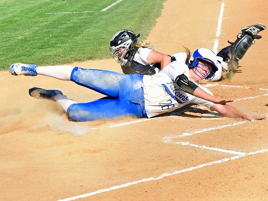 Lower Dauphin's Kealey Smith gets around Greencastle catcher Mackenzie Oberholzer to score a run. Greencastle pulled off a stunning comeback to beat Lower Dauphin 7-6 in a Mid Penn Conference softball game Tuesday, May 16, 2017 in Newville.