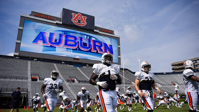 Airman First Class Cameron Kennedy surprised his family with a special message on Auburn University's new Jumbotron video board.