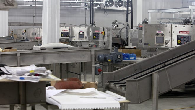 A row of vacuum packaging machines at the end of the packaging area at the Northern Beef Packers plant is shown in this February 2012 photo.