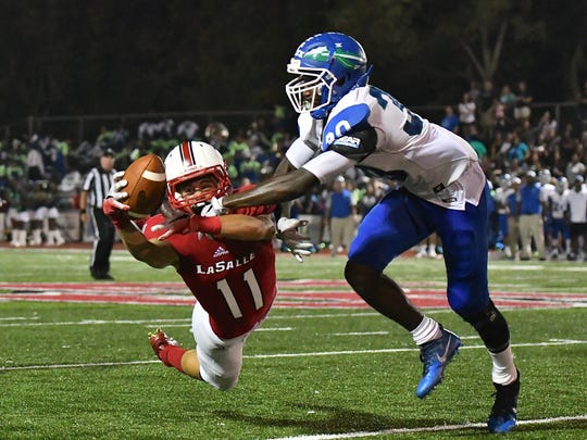 LaSalle's Jake Seibert nearly pulls off a miraculous catch in the second half against Winton Woods Friday, September 22nd at LaSalle High School