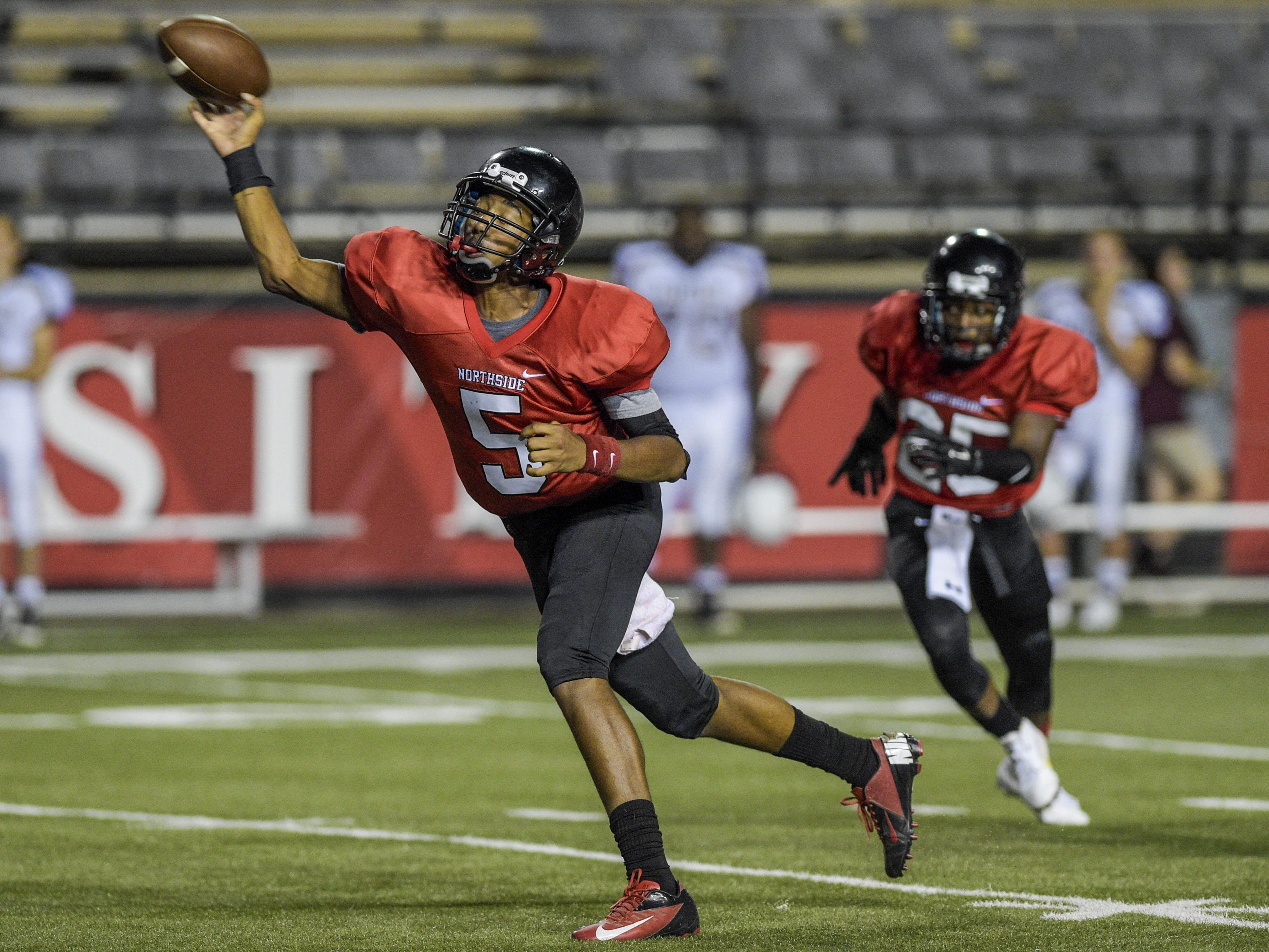 Northside quarterback Markaylon Boyd (5) showed his potential with a touchdown pass during the 12-6 win over Jennings in the jamboree.