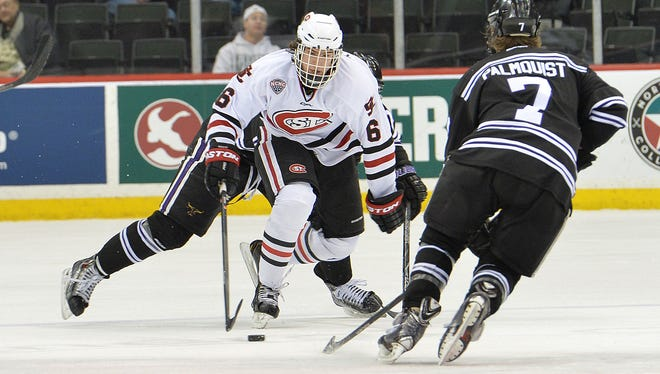 St. Cloud State's Daniel Tedesco (6) maneuvers around MSU-Mankato's Zach Palmquist (7) during the North Star College Cup last season at the Xcel Energy Center in St. Paul.