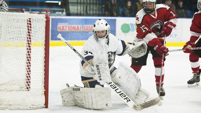 Essex goalie Sam Foster (30) watches the puck during the boys hockey game between the Champlain Valley Union Redhawks and the Essex Hornets at the Essex Skating Facility on Saturday.