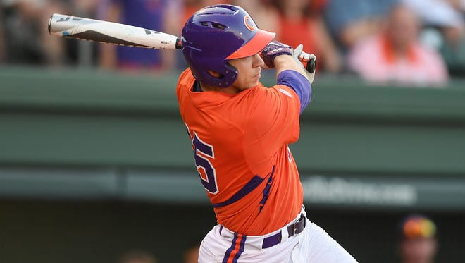 Clemson's Weston Jackson laces an RBI triple in the third inning of the Tigers' 10-5 win against Furman Tuesday night at Fluor Field.