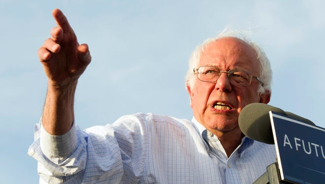 In this June 9, 2016, photo, Democratic presidential candidate Sen. Bernie Sanders, I-Vt., speaks at a rally in Washington.