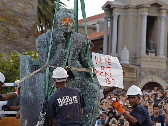 This statue of Cecil John Rhodes was removed from the campus at the Cape Town University, but another of the British colonialist still stands in a city park.