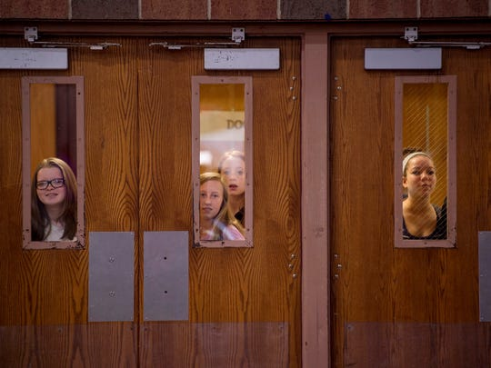 Curious students take in the happenings at the senior citizen prom in the Henderson County High School gymnasium Monday morning.