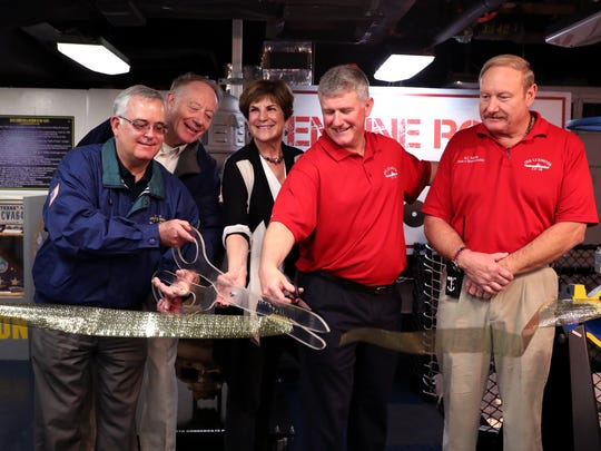 Bob Lacy (from left), Andrew Ott, Linda Monica, Steve Banta, and Rusty Reustle cut the ribbon on the newest exhibit at the Lexington Museum on the Bay, the Heart of Every Ship exhibit, during its grand opening Wednesday, Jan. 31, 2018. The exhibit will allow visitors to the ship to see and touch the critical equipment that kept the ships alive and includes a small theater where they can view a tutorial on engineering.