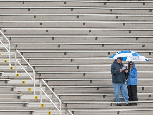 Delaware lacrosse fans brave the rain to watch Delaware take on Drexel on Saturday afternoon, March 29, 2014. Delaware lost to Drexel by a score of 9-7.