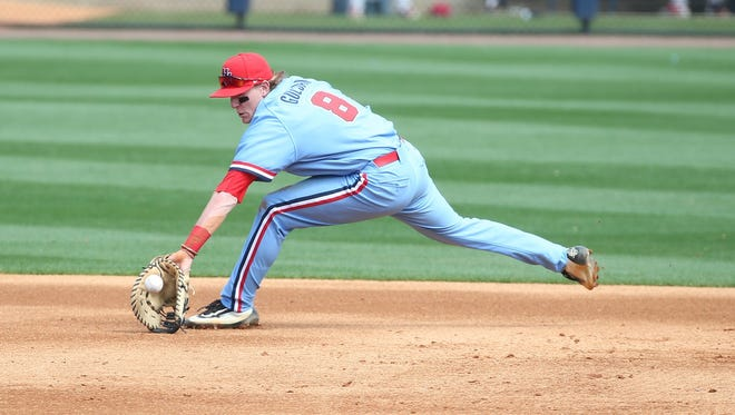 First baseman Will Golsan fields a ground ball against South Carolina. He drove in four runs Sunday against Arkansas as Ole Miss swept the Razorbacks.