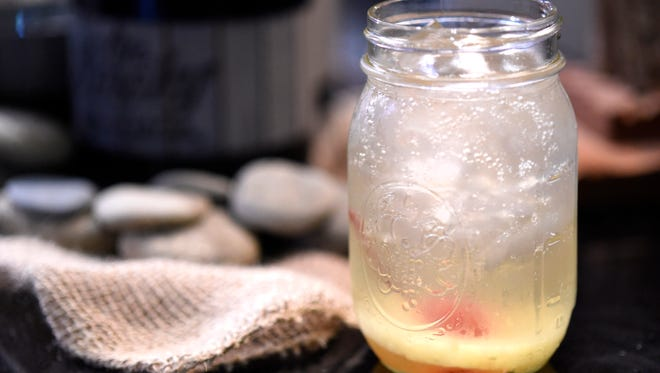 A pineapple moonshine white sangria is served at the Park Grill Restaurant in Gatlinburg on Thursday, April 16, 2015. The restaurant offers 12 cocktails, two appetizers, four entrees, a side dish, three desserts prepared with moonshine.