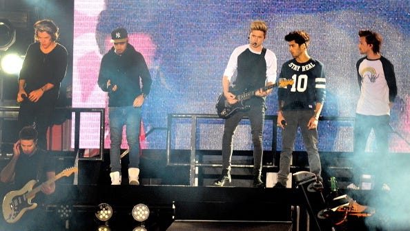 British Group One Direction perform in concert in Santiago, on April 30, 2014. AFP PHOTO/ FRANCESCO DEGASPERI        (Photo credit should read FRANCESCO DEGASPERI/AFP/Getty Images)