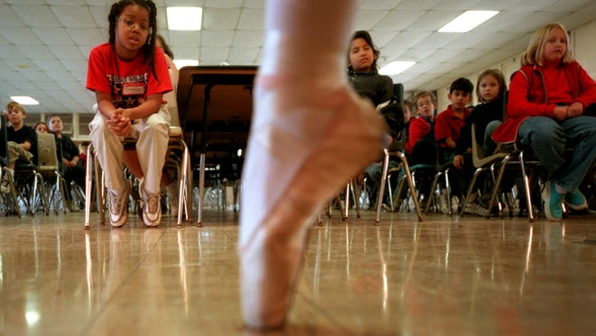 Wilson Elementary third-graders watch a ballerina from the Corpus Christi Concert Ballet dance past on the tips of her toes at a school performance in 2012.