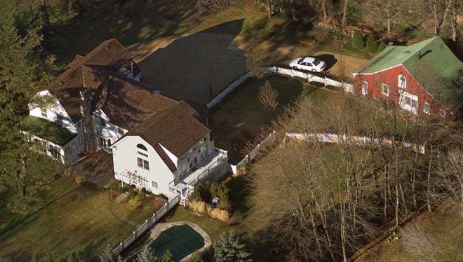 President Bill Clinton and Hillary Rodham Clinton's home is seen from the air in Chappaqua. The server computer that transmitted and received Hillary Clinton's emails on a private account she used exclusively for official business when she was secretary of state traced back to a residential Internet service registered at her family's five-bedroom home in Chappaqua, according to Internet records reviewed by The Associated Press.