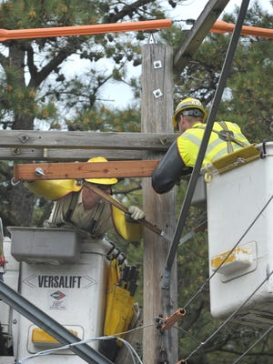 Atlantic City Electric workers are seen in a 2013 file photo.