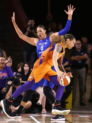 Phoenix Mercury's Brittney Griner drives to the basket and scores past Dallas Wings Liz Cambage in the first half during the round one of the WNBA Playoffs on Aug. 21, 2018, at Wells Fargo Arena in Tempe, Ariz.