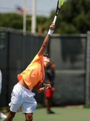 Jaycer Lyons, from Houston, serves the ball during his match against Roger Chou in the Boys' 18 singles division of USTA Texas Grand Slam on Wednesday, June 14, 2017, at the Streich Tennis Center.
