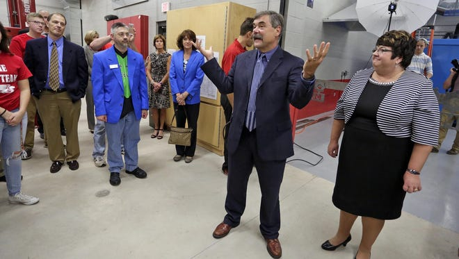 Sheboygan Area School District Superintendent Dr. Joseph Sheehan, left, and School Board President Marcia Reinthaler introduce the Red Raider Manufacturing Kohler/Johnsonville Advanced Technology Center during a dedication Tuesday October 18, 2016 at Sheboygan South.